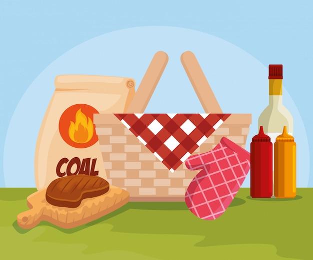 Carne e cesta com carvão e molhos
