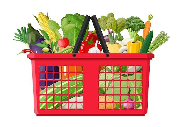 Carrinho de compras de plástico cheio de vegetais.