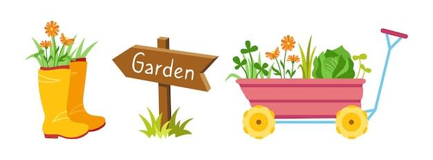 Carrinho de jardim com brotos de flores e botas de borracha