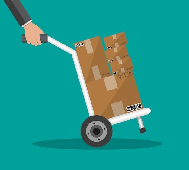 Carrinho de mão metálico com caixas