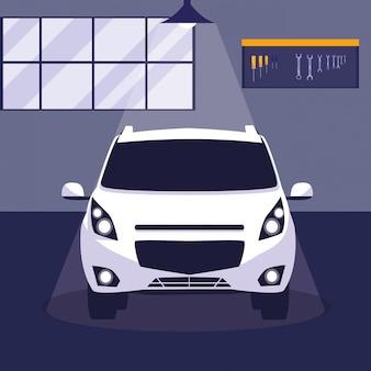 Carro branco na oficina de manutenção