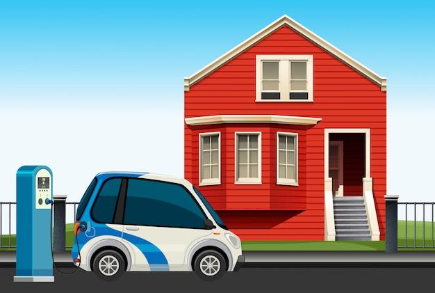 Carro elétrico cobrando na frente da casa
