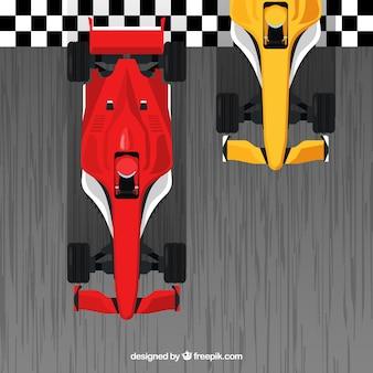 Carros de corrida vermelho e laranja f1 cruzando a linha de chegada
