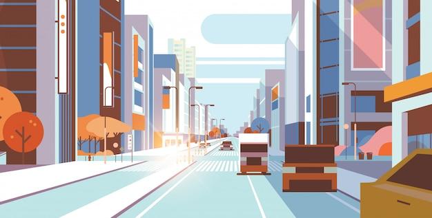 Carros dirigindo tráfego rodoviário urbano rua arranha-céu