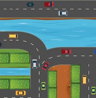 Carros na estrada ao longo do rio