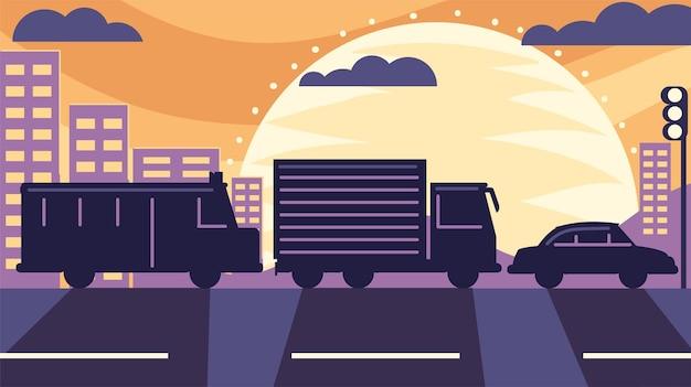 Carros na estrada com a cidade