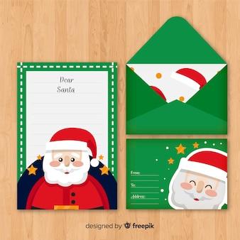 Carta de natal e envelope com santa