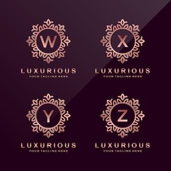 Carta de ouro rosa w, x, y, z logo