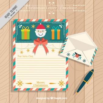 Carta linda de papai noel com envelope e pena