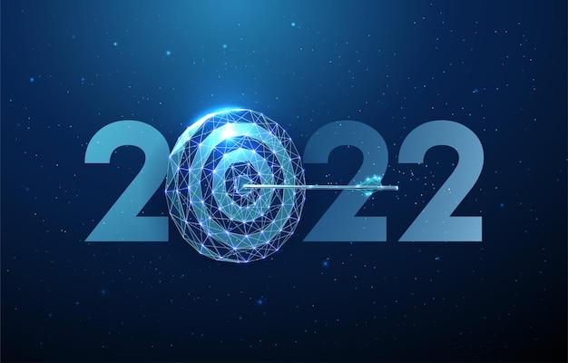 Cartão abstrato de feliz ano novo de 2022 com a seta alcançada no centro do tabuleiro de dardos