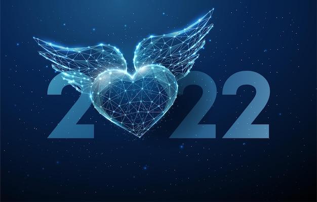 Cartão abstrato feliz ano novo de 2022 com um coração azul voador com asas vetor de estilo low poly