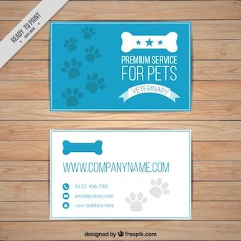 Cartão azul animal de estimação com impressões digitais e osso