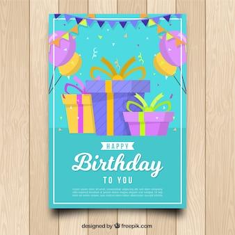 Cartão birhtday com caixas de presente em estilo plano