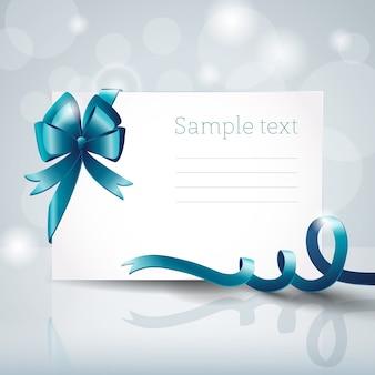 Cartão branco em branco com grande laço de fita azul e campo de texto