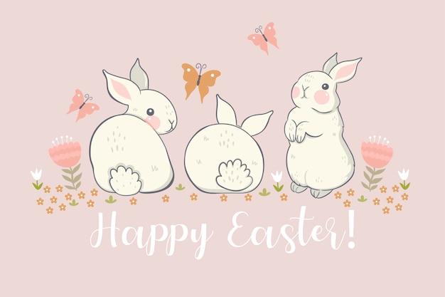 Cartão com coelhinhos e flores e a inscrição feliz páscoa