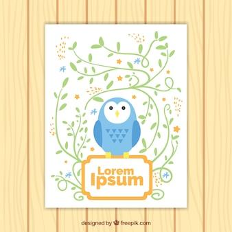 Cartão com coruja azul e decoração floral