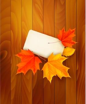 Cartão com folhas em fundo de madeira. .