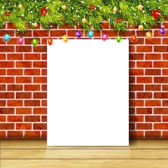 Cartão com galhos de árvores de natal, guirlandas e parede de tijolos