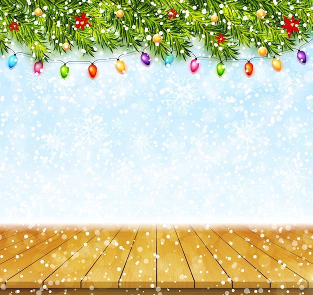 Cartão com galhos de árvores de natal, guirlandas e tampo da mesa de madeira. fundo de saudação de feliz natal e feliz ano novo