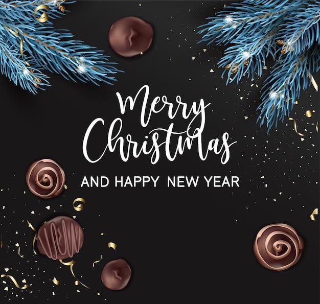 Cartão com galhos de pinheiro e bombons de chocolate doce