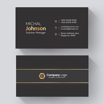Cartão corporativo elegante com detalhes em ouro e cinza