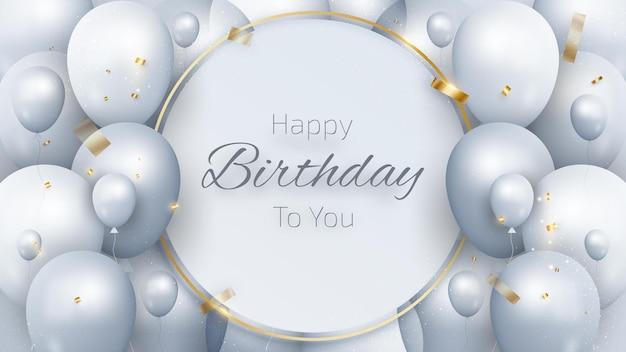 Cartão de aniversário com balões e fita de ouro.