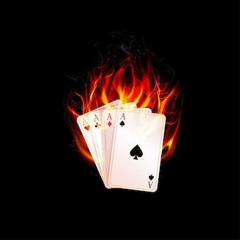 Cartão de ases queimando fogo sobre um fundo preto