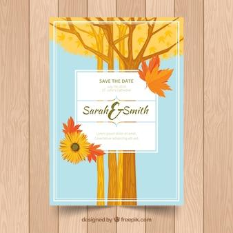 Cartão de casamento com árvores, folhas e flores