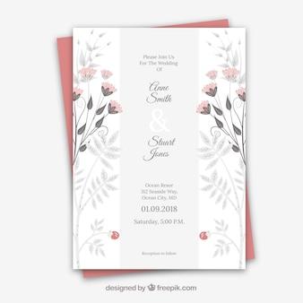 Cartão de casamento com ornamentos florais