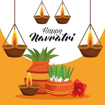 Cartão de celebração do feliz navratri com plantas e velas