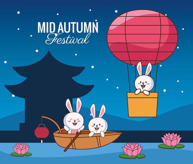 Cartão de celebração do meio do outono com coelhinhos em um barco e um balão de ar quente.