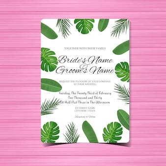 Cartão de convite de casamento com lindas folhas tropicais