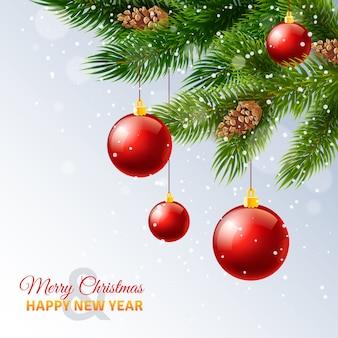 Cartão de cumprimentos de ano novo de temporada de férias com neve e galhos de árvore de natal decorada