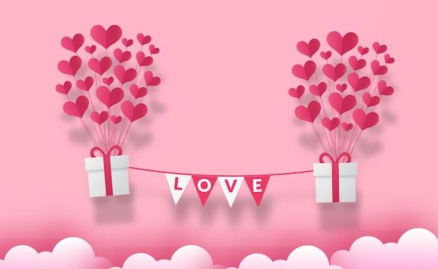 Cartão de dia dos namorados com balão de amor de coração e caixa de presente estilo corte de papel