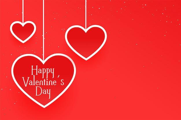 Cartão de dia dos namorados vermelho limpo com corações de suspensão