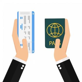 Cartão de embarque e passaporte nas mãos