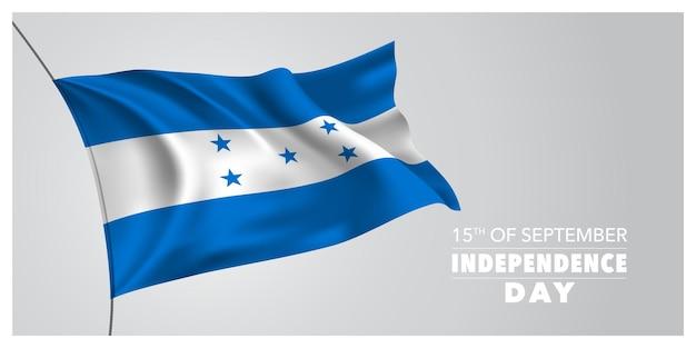 Cartão de felicitações de feliz dia da independência de honduras, banner, ilustração vetorial horizontal. elemento de design do feriado de 15 de setembro com uma bandeira agitando como um símbolo de independência