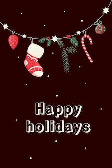 Cartão de felicitações de natal e ano novo com elementos de decoração festiva na guirlanda boas festas