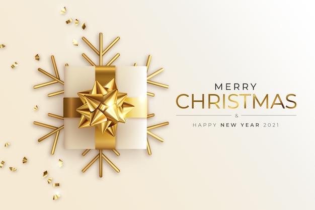 Cartão de felicitações de natal e ano novo com presente de ouro realista