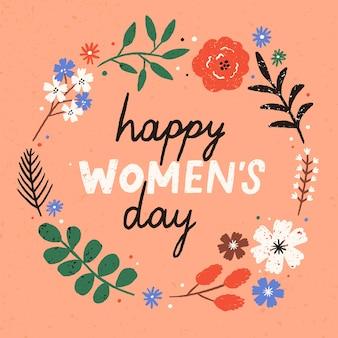 Cartão de felicitações ou modelo de cartão postal com desejo do feliz dia da mulher escrito à mão dentro de moldura floral redonda ou coroa feita de flores desabrochando