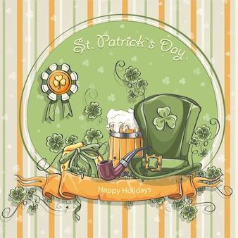 Cartão de felicitações para o dia de são patrício com a foto de um chapéu, uma caneca de cerveja e folhas de trevo