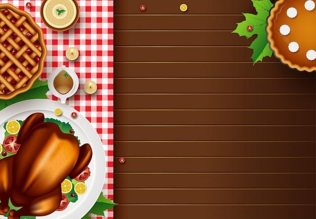 Cartão de feliz ação de graças com elementos de outono sobre fundo de madeira com copyspace