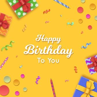 Cartão de feliz aniversário com presente, velas e confetes