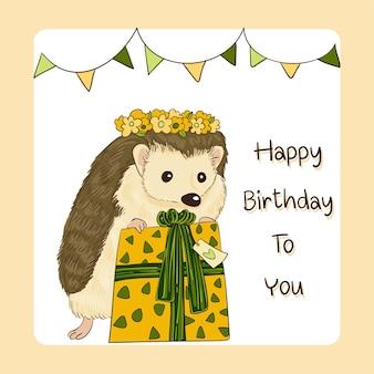 Cartão de feliz aniversário decorado com um ouriço arranhando uma caixa de presente