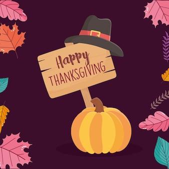 Cartão de feliz dia de ação de graças com folhagem de outono chapéu de peregrino de placa de madeira abóbora