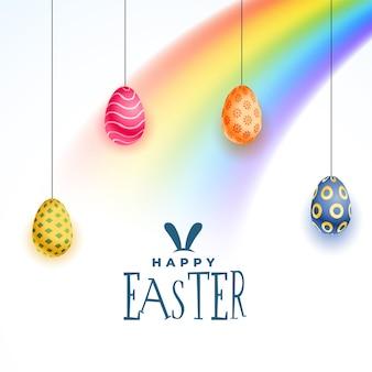 Cartão de feliz dia de páscoa com ovos coloridos e arco-íris