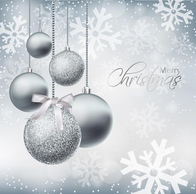 Cartão de feliz natal com enfeites de prata