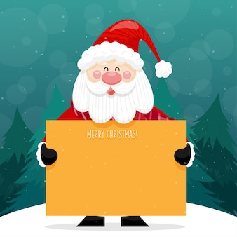 Cartão de feliz natal com o papai noel segurando um cartaz e em pé na neve com um pinheiro
