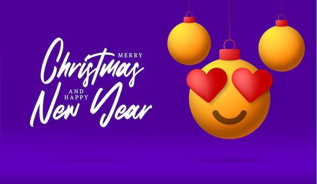 Cartão de feliz natal com rosto de emoji de sorriso de coração. ilustração vetorial em estilo simples com letras de natal e amor e emoção na bola de natal pendurada no fio no fundo roxo