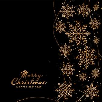 Cartão de feliz natal preto com flocos de neve dourados
